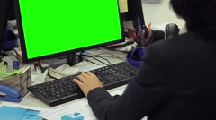Woman using computer with green screen Stock Footage