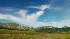 Timelapse of green pasture. Campo Imperatore, Abruzzo, Italy. Gran sasso view. Stock Footage
