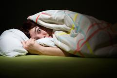 Young woman in bed with eyes opened suffering insomnia. Sleeping concept and Stock Photos