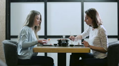 Two girls talking in a Japanese restaurant Stock Footage