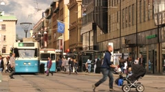 People cross the street in Gothenburg, Sweden. Stock Footage