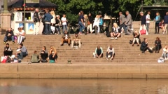 People relax at the riverside in Gothenburg, Sweden. Stock Footage