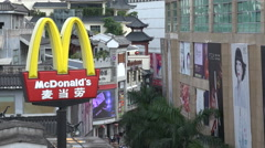 Golden arches of McDonald's logo in popular shopping street Shenzhen China Stock Footage