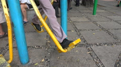 Feet and legs of a Chinese senior man doing exercises in a park in Shenzhen Stock Footage