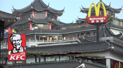 China contrast, Western fast food chains, old traditional temple complex Stock Footage