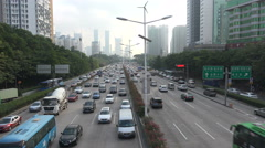 Traffic drives over a busy highway during rush hour in central Shenzhen Stock Footage