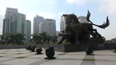 Bull statue in front of the new Shenzhen Stock Exchange building in China Stock Footage