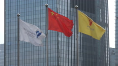 Two flags of the Shenzhen stock exchange and the Chinese national flag Stock Footage