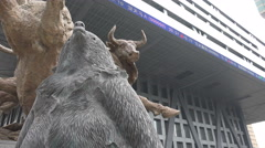 Bear and bull statue at Shenzhen stock exchange in China - stock footage