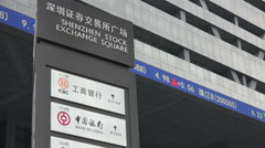 Shenzhen stock exchange square, ticker board, bank offices China Stock Footage