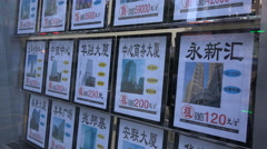 Window advertising of real estate agents, residential property market China Stock Footage