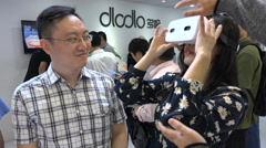 China industry, woman tries virtual reality glasses at a technology trade show Stock Footage