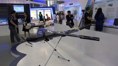 A surveillance drone on display at a technology trade show in Shenzhen, China Stock Footage