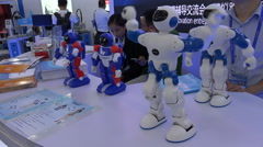 A dancing robot on display at a trade fair in Shenzhen, China Stock Footage