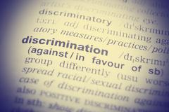 Dictionary definition of the word discriminate - stock photo