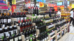 China Western (French) supermarket Carrefour, wine bottles, middle class Stock Footage