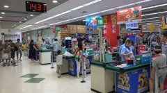 Checkout counters (cash registers) of a Western supermarket in Shenzhen, China Stock Footage