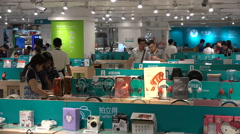 Chinese electronics store, urban lifestyle, consumption, middle class China Stock Footage