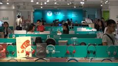 China domestic consumption, busy consumer electronics store in Shenzhen city Stock Footage