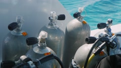 Cylinders with compressed air for diving on floating ship - stock footage