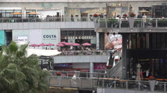 Western style restaurant and cafes in a modern shopping mall in Shenzhen, China Stock Footage