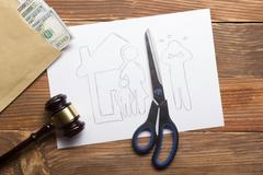 Family law concept. Divorce section of the property by legal means. Scissors - stock photo
