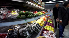 Chinese shoppers in an duty-free supermarket - stock footage