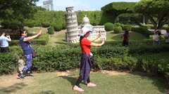 China tourism, miniature leaning tower of Pisa, entertainment park in Shenzhen - stock footage