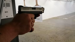 Close up of firing pistol Stock Footage