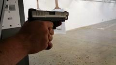 Close up of shooting handgun Stock Footage