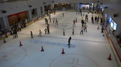 China entertainment, middle class, children ice skating, playing hockey, weekend Stock Footage