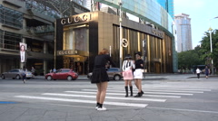 Young Chinese models take pictures, Gucci store, fashion, style, Asia Stock Footage