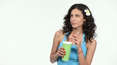 Woman holding paper cup with a straw Stock Footage