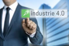 Industry 4.0 in german industrie browser is operated by businessman Stock Photos