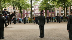 Horses Ride Past Soldiers Standing at Attention - The Hague Stock Footage