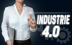 Industrie 4.0 in german industry touchscreen is operated by businesswoman Stock Photos