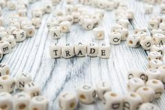 TRADE word background on wood blocks. Wooden ABC - stock photo