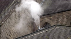 White smoke from top of church roof England 4K Stock Footage