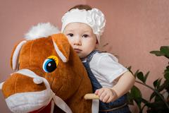Little girl and horse Stock Photos