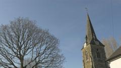 4k Church Steeple Clock Tower Tree Blue Sky Village Stock Footage