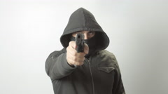 Hooded Masked Man Points Handgun at Camera Stock Footage