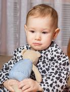 Little girl with a soft toy Stock Photos