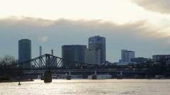 Eiserner Steg, Iron Footbridge, Frankfurt Main skyline, sunset on river Stock Footage
