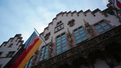 Römer city hall building, Germany flag, low angle, Frankfurt am Main Stock Footage