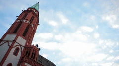 Old st. Nicholas Church, low angle, pan left, Frankfurt am Main, Germany Stock Footage