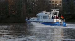 German police boat patrols Frankfurt main river, Germany - stock footage
