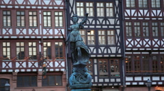 Justitia lady justice statue, timber houses, Römerberg city square, Frankfurt Stock Footage