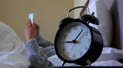 playing mobile phone, alarm clock at bedside - stock footage