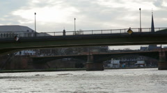 Fire truck with sirens drives over bridge, Frankfurt Main river, Germany Stock Footage