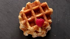 Belgian waffles with raspberries and sugar powder over rusty surface. Flat lay Stock Footage
